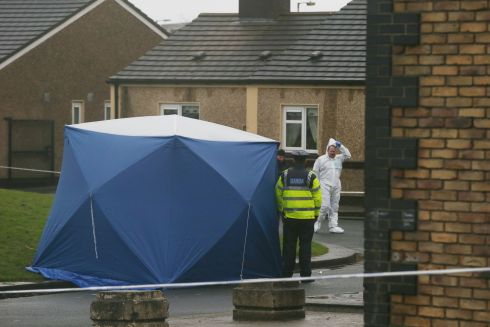 GANG FEUD SUSPICIONS: Garda technical bureau staff at the scene of the fatal shooting of Derek Coakley-Hutch at Bridgeview halting site in Dublin. Photograph: Stephen Collins