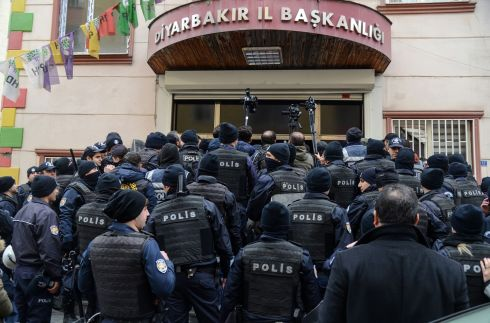 "OLIVE BRANCH PROTEST: Turkish riot police officers block the Peoples Democratic Party HQ in Diyarbakir after members called a protest against Turkey's ""Olive Branch"" military operation against the Peoples' Protection Units (YPG), a Kurdish militia, in Afrin, northern Syria. Photograph: Ilyas Akengin/AFP/Getty Images"