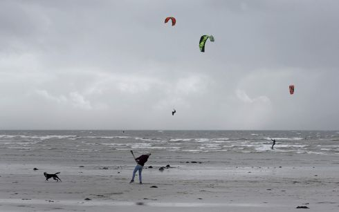 WINDY WAY: Kitesurfers take advantage of windy weather at Silverstrand in Galway. Photograph: Joe O'Shaughnessy.