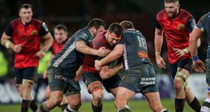 Munster's Jean Kleyn is tackled by Castres' Tudor Stroe and Daniel Kotze at Thomond Park. Photograph: Gary Carr/Inpho
