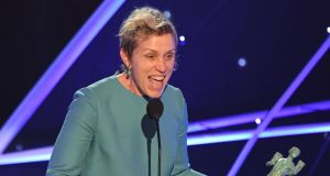 Frances McDormand receives the award for Outstanding Performance by a Female Actor in a Leading Role during the 24th Annual Screen Actors Guild Awards show at The Shrine Auditorium on January 21st, 2018 in Los Angeles, California. Photograph: MARK RALSTON/AFP/Getty Images