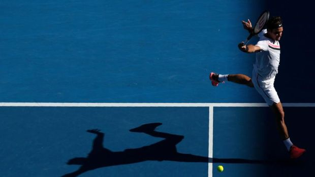 Roger Federer of Switzerland hits a shot against Marton Fucsovics of Hungary during their clash at the Australian Open. Photo: Edgar Su/Reuters