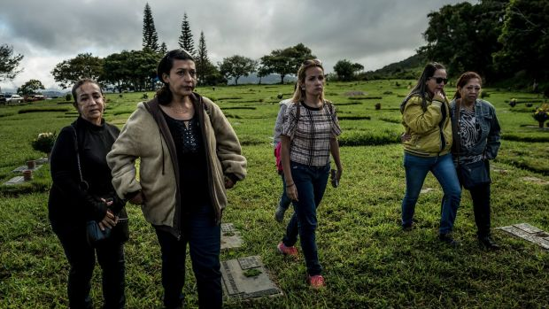 Aura Pérez (left), aunt of Óscar Pérez, who claimed his body from the morgue, walks to his grave in El Hatillo, Venezuela on Sunday. Photograph: Meridith Kohut/The New York Times