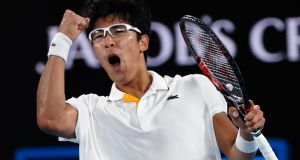 Chung Hyeon of South Korea celebrates after beating Novak Djokovic at the Australian Open. Photo: Issei Kato/Reuters
