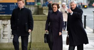 Former Bank of Ireland official Liam McLoughlin can be seen on the left, along with colleagues Lynda Carragher and Richie Boucher.