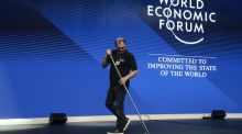 Sweeping the stage in a session hall at the Congress Centre during preparations for the World Economic Forum  in Davos at which the world's rich and powerful will gather. Photograph: Jason Alden/Bloomberg