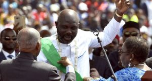 Liberia's President-elect and former football star George Weah at his swearing-in ceremony in Monrovia. Photograph: AFP/Getty Images
