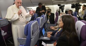 Pope Francis  speaks to journalists aboard his flight to Italy at the end of his visit to South America on Monday. Photograph: EPA/Luca Zennaro