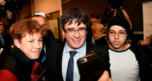 Former Catalan president  Carles Puigdemont poses for photographs with students as he leaves the University of Copenhagen after attending a debate on Monday. Photograph:  Jonathan Nackstrand/AFP/Getty Images