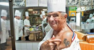 Chef Paul Bocuse showing off his tattoo. Photograph: Paul Bocuse/Facebook