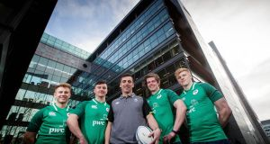 Ireland under-20 players Jonny Stewart, Diarmuid Barron, head coach Noel McNamara, Sean Masterson and Tommy O'Brien. Photograph: Ryan Byrne/Inpho