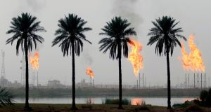 APOCALYPSE NOW: Flames rising from the burning of excess hydrocarbons at the Nahr Bin Omar natural gas field, north of the southern Iraqi port of Basra. Iraq will is expected to sign a memorandum of understanding with US energy company Orion to tap gas at the oil field in the south of the country, the petroleum ministry said. Photograph: Haidar Mohammed Ali/AFP/Getty Images