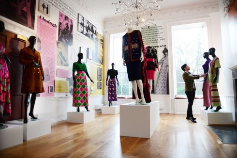 PERFECT: Exhibition designer David Meaney adds some final touches to a stunning new exhibition of fashion at the Little Museum of Dublin. Photograph: Bryan O'Brien/The Irish Times