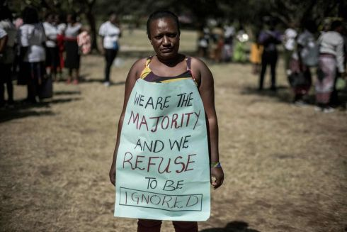 TIME'S UP: A woman poses with a message as hundreds of activists marched to protest repeated failures to apply laws that women must hold at least a third of government seats in Nairobi, Kenya. The National Assembly has 349 MPs, there are only 76 women. Photograph: Yasuyoshi Chiba/AFP/Getty Images