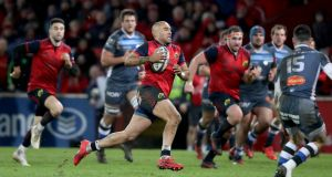 Simon Zebo runs in a try for Munster against Castres. The winger would be part of Ireland's Six Nations squad if it was picked on merit. Photograph: Dan Sheridan/Inpho