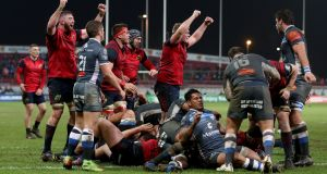 Munster  celebrate as James Cronin scores a try against Castres  Olympique at Thomond Park. Photograph: Dan Sheriedan/Inpho