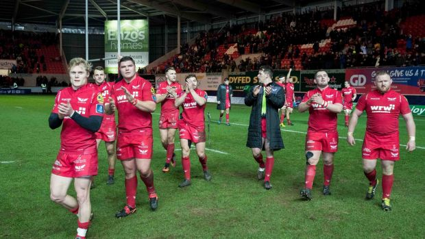 Scarlets celebrate sealing their quarter-final place with an exciting victory over Toulon at Parc y Scarlets, Llanelli. Photograph: Morgan Treacy/Inpho