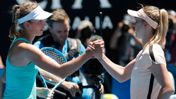 Elise Mertens and Elina Svitolina shake hands after their Australian Open quarter final clash. Photo: Mast Irham/EPA