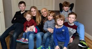 Jen Hogan with her daughter Chloe and sons from left, Adam, Noah, Zach, Tobey, Luke and Jamie pictured in their home in Co Dublin. Photograph: Cyril Byrne