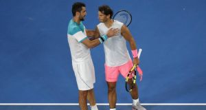 Marin Cilic of Croatia and Rafael Nadal of Spain embrace after Nadal retired from their match at the Australian Open. Photo: Toru Hanai/Reuters