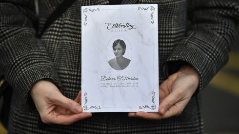 A member of the congregation holds up an order of service ahead of Dolores O'Riordan's funeral. Photograph: Charles McQuillan/Getty Images