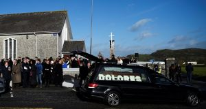 Mourners leave Dolores O'Riordan, the singer of the Cranberries' funeral at St Ailbe's Church in Ballybricken on Tuesday. Photograph: Reuters