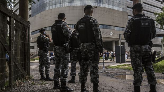 The Special Operations Batallion stand guard in front of the 4th Federal Court building ahead of former president Luiz Inacio Lula da Silva's appeal hearing in Porto Alegre, Brazil. Photograph: Dado Galdieri/Bloomberg