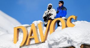 Swiss armed security personnel on the rooftop of a hotel in Davos on the opening day of the World Economic Forum. Photograph: Abrice Coffrini/AFP