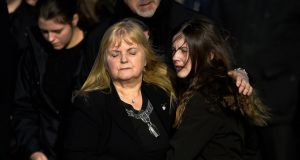 Dolores O'Riordan's ex-husband Don Burton (background) , mother Eillen O'Riordan and her  daughters Molly (Left) and Dakota (Right) at St Ailbe's Church in Ballybricken, for the funeral of the Cranberries singer. REUTERS/Clodagh Kilcoyne
