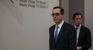 US treasury secretary Steven Mnuchin leave a press briefing at the World Economic Forum in Davos. Photograph: Jason Alden/Bloomberg