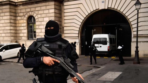 Armed police stand guard as a van carrying Jawad Bendaoud arrives at the courthouse in Paris on Wednesday. Photograph: Christophe Simon/AFP/Getty Images