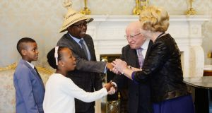 President Michael D Higgins and his wife Sabina greet Kutloano Pheko, charge d'affaire for the Embassy of Lesotho, and his children Riaz and Lumka at Áras an Uachtaráin. Photograph: Alan Betson