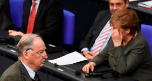 AfD parliamentary group co-leader Alexander Gauland walks past German chancellor Angela Merkel in the Bundestag in Berlin. Photograph: John MacDougall/AFP/Getty Images