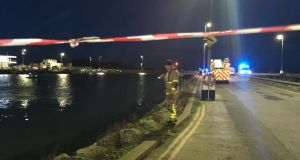 Howth harbour, where a car has fallen into the water. Emergency services are at the scene