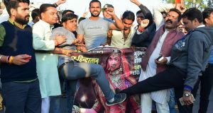 Protesters kick a poster of the Bollywood film Padmaavat during a protest in Bhopal, India, on Wednesday. Photograph: Dominique Faget/AFP/Getty Images