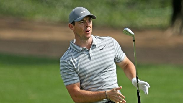 McIlroy reacts to his second shot on the par four, ninth hole. Photo: David Cannon/Getty Images
