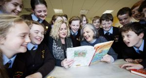 Fourth class pupils at St Clare's Primary School in Harold's Cross, Dublin, with Arts Council director Orlaith McBride and writer Siobhán Parkinson. The Writers in Schools programme recently celebrated its 40th birthday. Photograph:  Andres Poveda