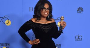 Actress and TV talk show host Oprah Winfrey with the Cecil B DeMille Award during the 75th Golden Globe Awards in Beverly Hills, California earlier this month. Photograph:  Frederic J Brown/AFP/Getty Images