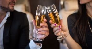 Upgrade: Enter a world of champagne and calm and canapés and cutlery.  Photograph: Getty Images/E+