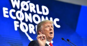 "US president Donald Trump: told the World Economic Forum  in Davos that ""America is open for business"". Photograph: Nicholas Kamm/AFP/Getty Images"