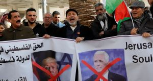 Palestinian demonstrators shout slogans as they hold posters with  crossed out  images of US president Donald Trump and vice-president Mike Pence during a protest against Mr Pence's visit to Israel, in the West Bank city of Nablus, earlier this week. Photograph: Abed Omar Qusini/Reuters