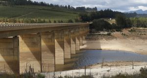 The critically low Theewaterskloof Dam in Villiersdorp, South Africa,  the single biggest dam supplying water to the metropolis of Cape Town. 'Day Zero', when the water runs out in the city, is estimated to be April 20th. Photograph: Nic Bothma/EPA