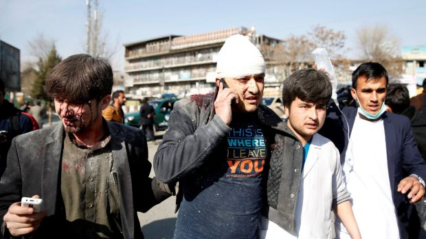 People assist an injured man after a blast in Kabul, Afghanistan, on Saturday. Photograph: Reuters