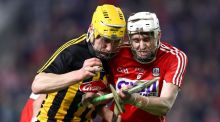 Kilkenny's Ollie Walsh and Tim O'Mahony of Cork clash. Photograph:  James Crombie/Inpho
