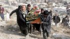 People attend the funeral of one of the victims of a suicide bomb attack, in Kabul. Photograph: Amid Heday Atullah/EPA
