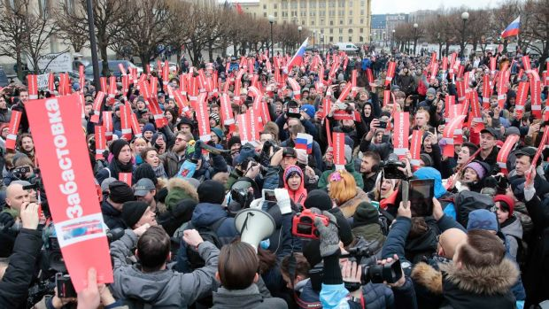 Supporters of Russian opposition leader Alexei Navalny attend a rally on Sunday calling for a boycott of the presidential election. Photograph: Reuters