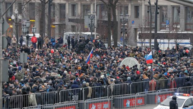 People gather in a square during the rally in Moscow on Sunday. Photograph: Reuters
