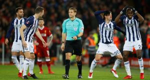 West Bromwich Albion's Grzegorz Krychowiak, Jonny Evans, Hal Robson-Kanu and Allan Nyom react after referee Craig Pawson awards a penalty to Liverpool after a VAR (Video Assistant Referee) review. Photograph: Phil Noble/Reuters