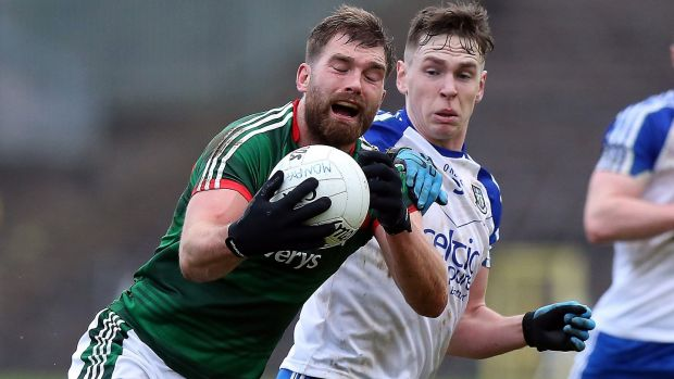Aidan O'Shea is challenged by Monaghan's Niall Kearns during Mayo's win in Clones. Photograph: John McVitty/Inpho