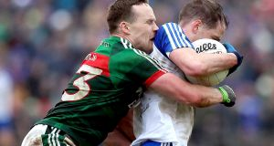 Andy Moran tackles Conor Boyle during Mayo's win over Monaghan. Photograph: John McVitty/Inpho